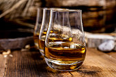 istock Speyside scotch whisky tasting on old dark wooden vintage table with barley grains 1227135754