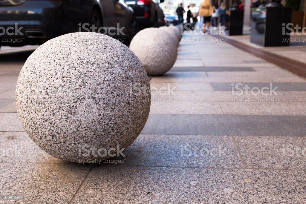 Sphere ball stone Bollards stock photo