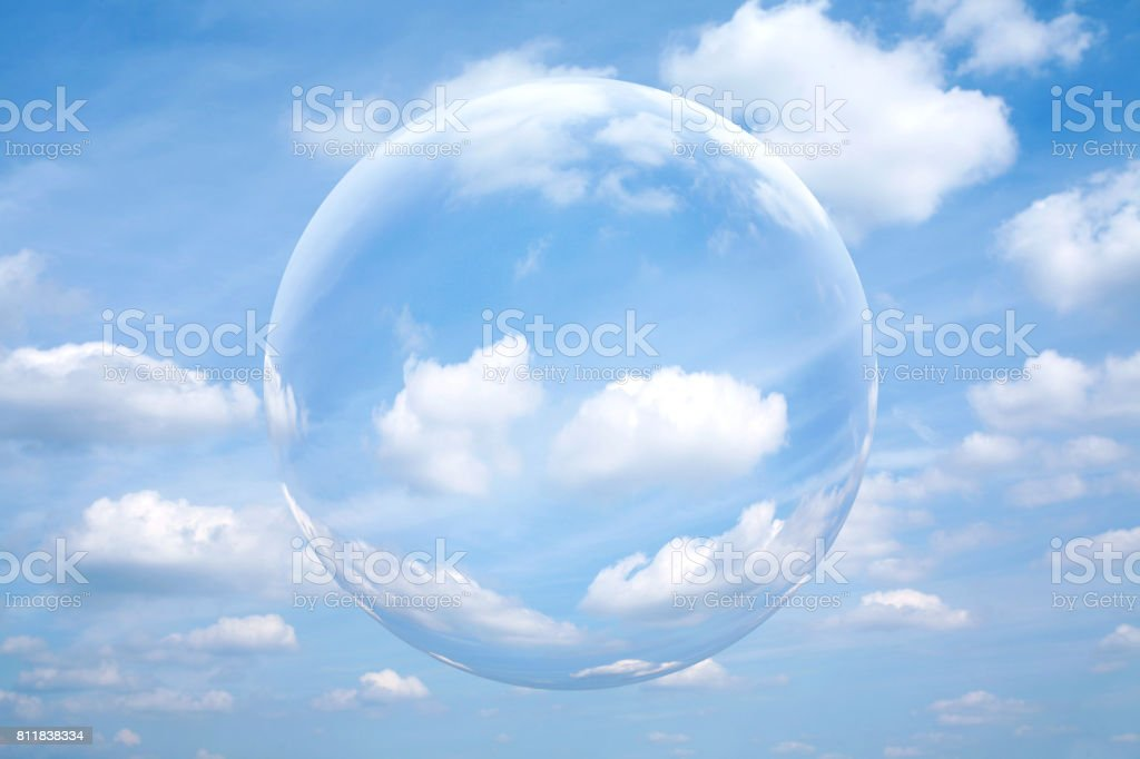 Sphere in the blue sky with white cloud stock photo