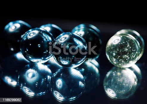 Crystal, transparent ball, sphere on a black background.