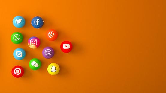 Istanbul, Turkey - November 05, 2018 : Sphere shape of popular social media services icons, including Facebook, Instagram, Youtube, Twitter, Whatsapp,, Snapchat, Pinterest, Viber, Google, Wechat, Skype on an orange desk