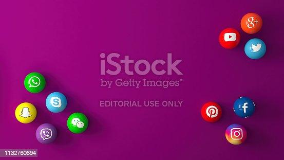 Istanbul, Turkey - February 28, 2019 : Sphere shape of popular social media services icons, including Facebook, Instagram, Youtube, Twitter, Whatsapp,, Snapchat, Pinterest, Viber, Google, Wechat, Skype on purple desk