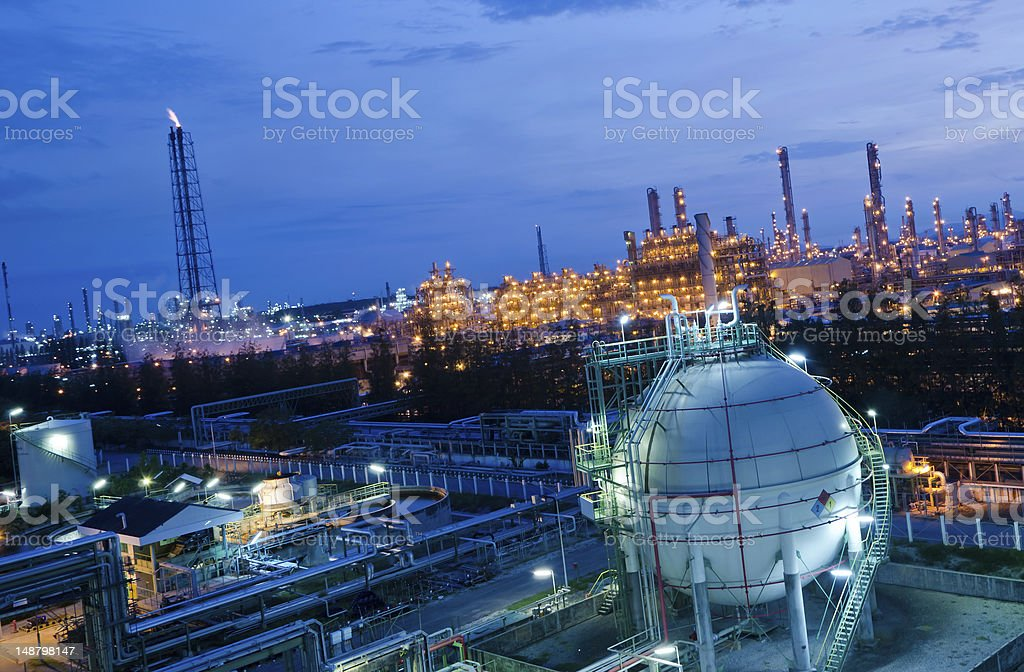 Sphere shaped gas storage tank in a petrochemical plant royalty-free stock photo