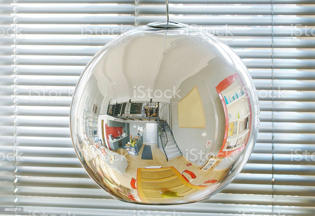 Spheric mirror lamp, kitchen and living-room reflected in royalty-free stock photo