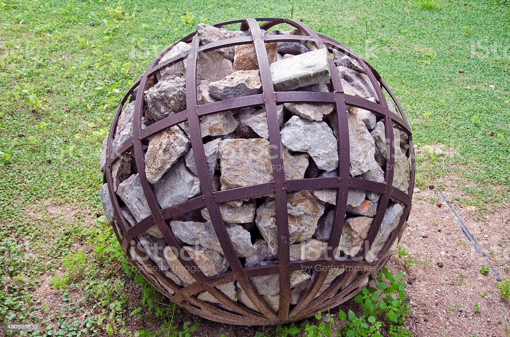 Spherical decorative object with stone in park, Greece stock photo