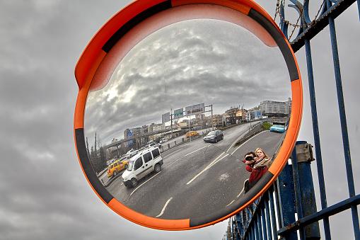 Istanbul, Turkey - February 12, 2020: Round spherical mirror for traffic control, Refik Saydam Street, Beyoglu area.