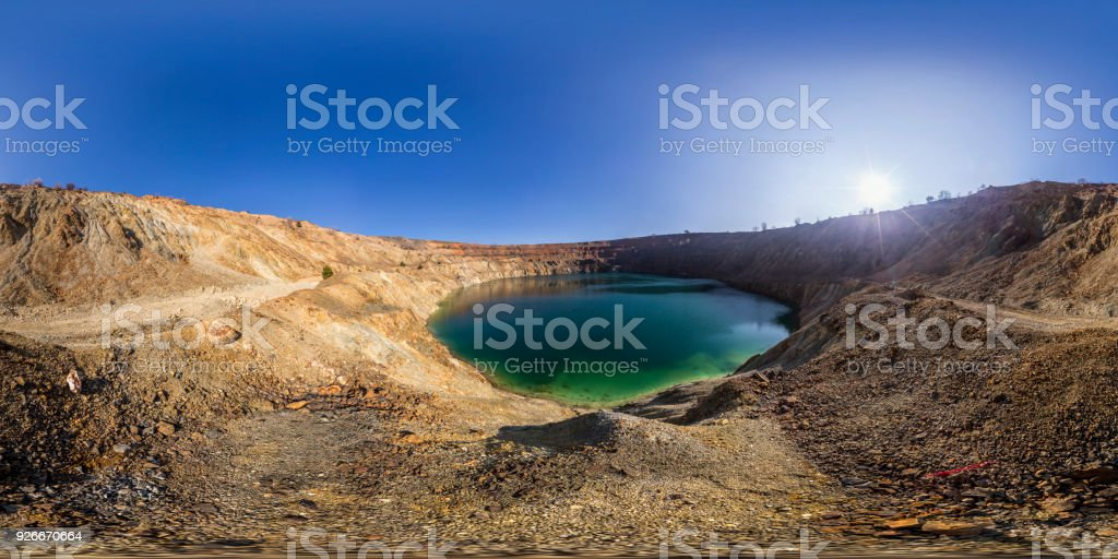 Spherical panorama of a mining crater in the Earth crust stock photo