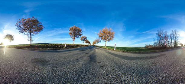 spherical panorama of asphalt country road with trees 360 degrees spherical panorama of a asphalt country road with trees at late afternoon in autumn - germany 360 degree view stock pictures, royalty-free photos & images