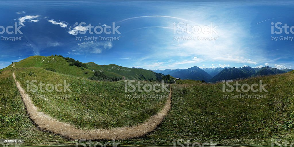 360° spherical panorama: Trail in an alpine meadow stock photo