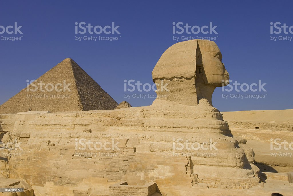 Sphinx and pyramid in Giza royalty-free stock photo