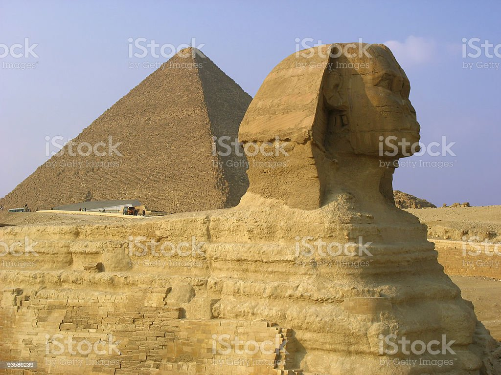 Sphinx and pyramids in Giza royalty-free stock photo