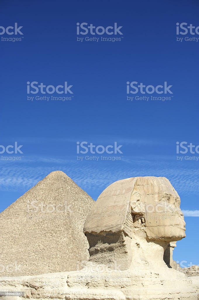 Sphinx Profile With Great Pyramid Blue Sky Egypt stock photo