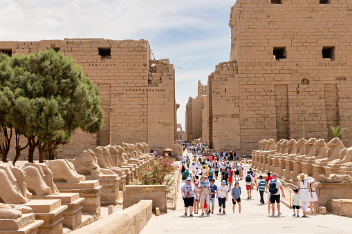 Sphinxes road at the Karnak Temple Complex in Luxor, Egypt. Tourists from all over the world are visiting the temple in Luxor.