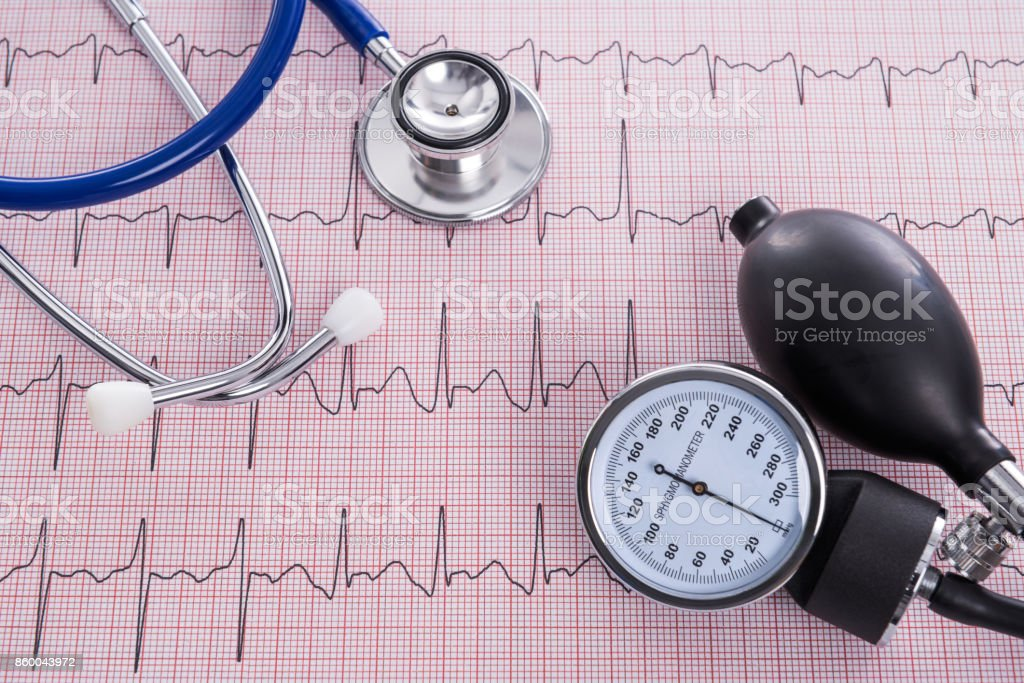 Sphygmomanometer and stethoscope with Electrocardiogram paper stock photo