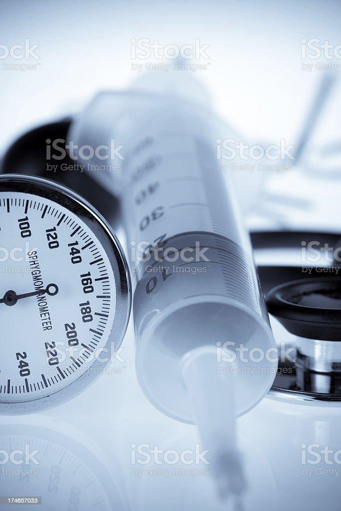 Sphygmomanometer, syringe and stethoscope royalty-free stock photo