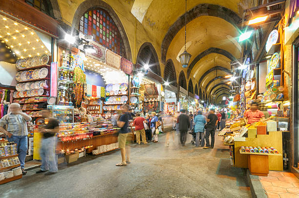 Spice Bazaar, Istanbul, Turkey Long exposure image of the Spice Bazaar (Turkish: Misir Carsisi meaning Egyptian Bazaar) in Istanbul, Turkey is one of the largest bazaars in the city. It's located in the Eminönü quarter of the Fatih district. asian market stock pictures, royalty-free photos & images