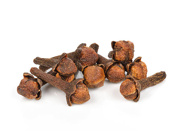 Spice cloves on white background Spice cloves on white background clove spice stock pictures, royalty-free photos & images