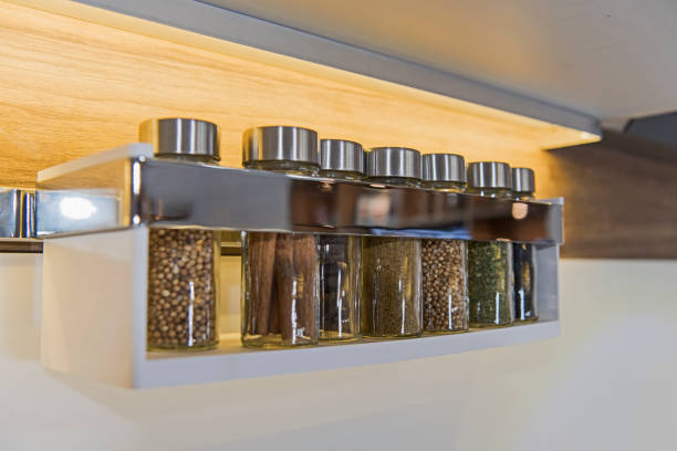 Spice jars on a wall rack stock photo