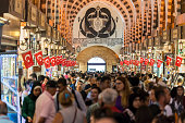 People visiting and shopping Spice Bazaar (Egyptian Bazaar) in Istanbul, Turkey. Spice Bazaar is one of the largest bazaars in the city. Located in the Eminönü quarter of the Fatih district, it is the most famous covered shopping complex after the Grand Bazaar.