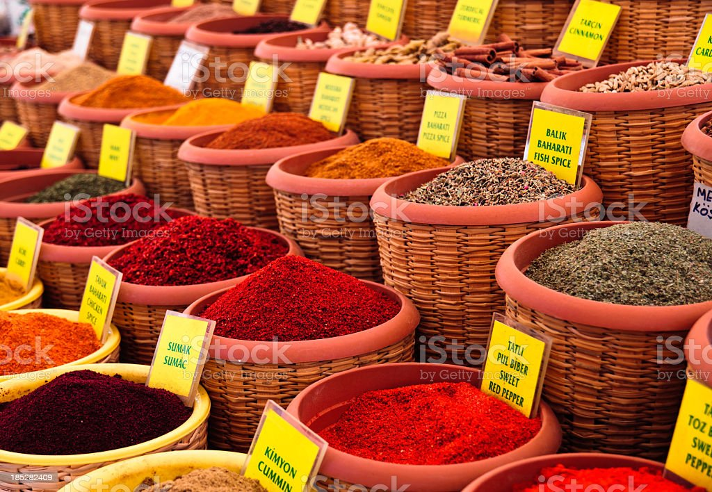 Spice market with baskets filled with spices stock photo