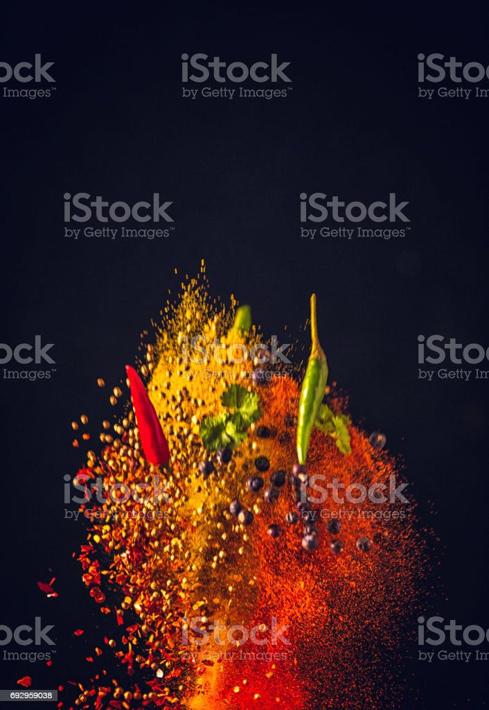 Spice Mix Food Explosion with Chili and Peppercorns stock photo