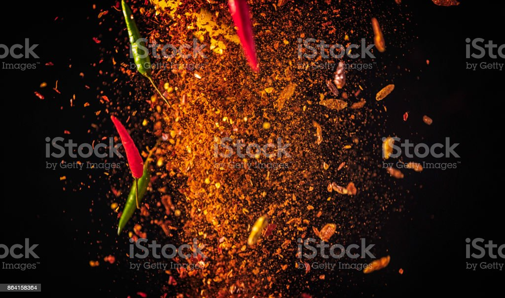 Spice Mix Food Explosion with Chili Peppers and Chili Powder royalty-free stock photo