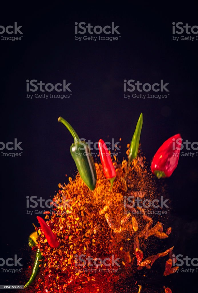 Spice Mix Food Explosion with Chili Peppers and Chili Powder stock photo