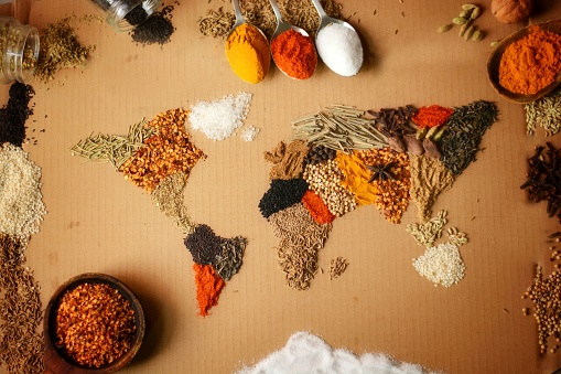 A world map made from spices used in kitchen