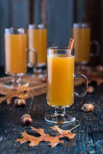 Spiced Apple Cider Beverages Enjoy sharing warm spiced apple cider with friends on cool autumn day hot apple cider stock pictures, royalty-free photos & images