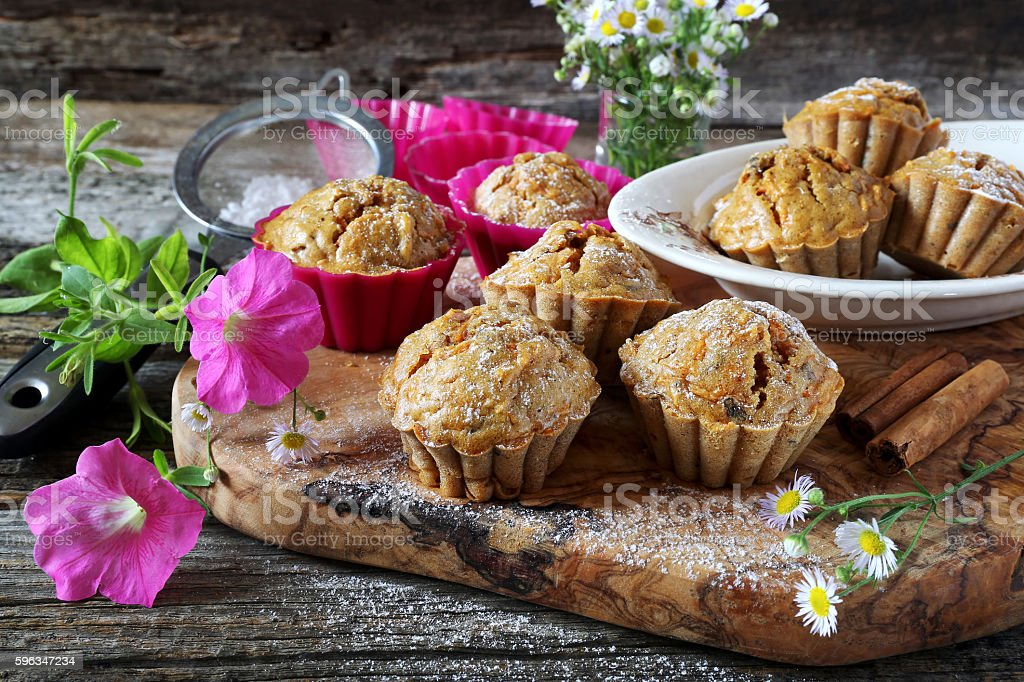 Spiced carrot muffins and summer flowers royalty-free stock photo