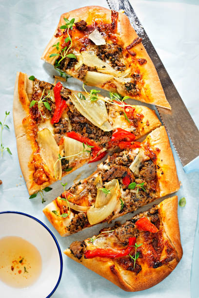Spiced lamb pide flatbread topped with tomato sauce, lamb, mozzarella, onion, red peppers Spiced lamb pide flatbread topped with tomato sauce, lamb, mozzarella, onion, red peppers zaatar spice stock pictures, royalty-free photos & images
