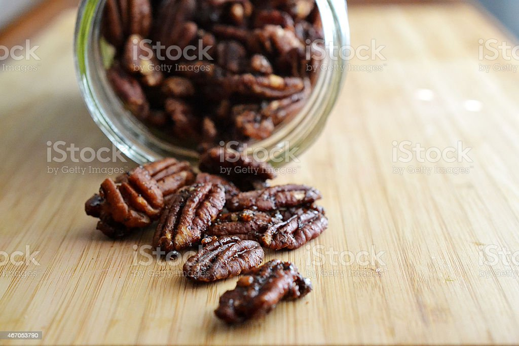 spiced pecans stock photo
