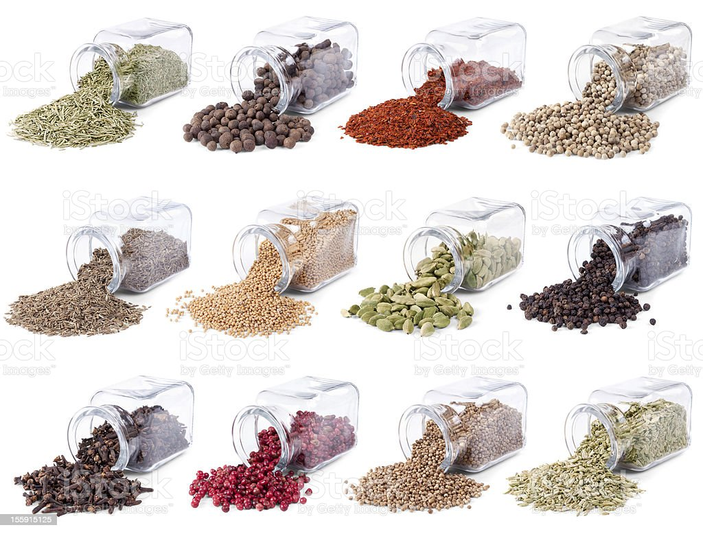 Spices and herbs are scattered on a white background stock photo