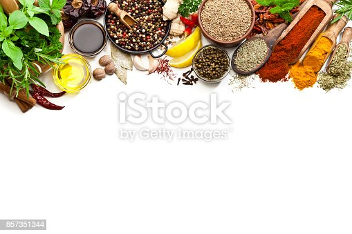 istock Spices and herbs border on white background 857351344