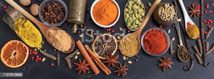 istock Spices and herbs. Colorful spices flat lay on wooden table 1137813655