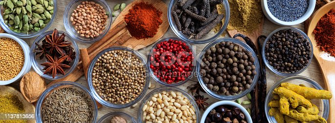 istock Spices and herbs. Colorful spices flat lay on wooden table 1137813656