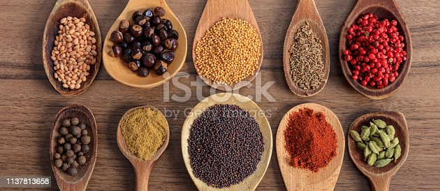 istock Spices and herbs. Colorful spices on wooden table, banner 1137813658