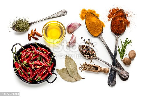 istock Spices and herbs isolated on white background 907728680