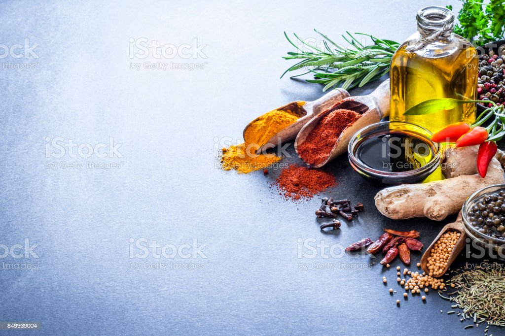 Spices and herbs on bluish kitchen table stock photo