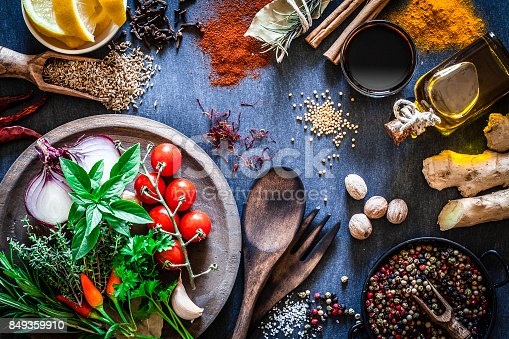 istock Spices and herbs on dark kitchen table 849359910