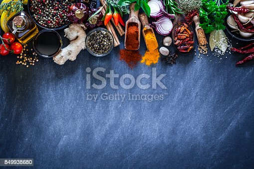 istock Spices and herbs on dark kitchen table 849938680