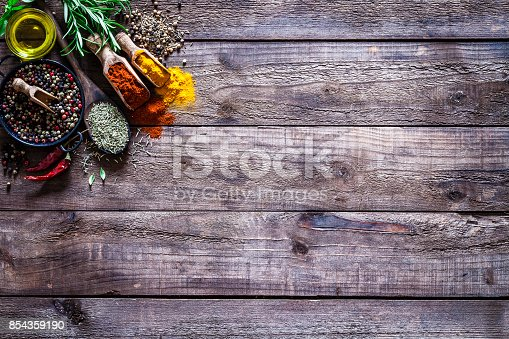 istock Spices and herbs on rustic wood kitchen table 854359190