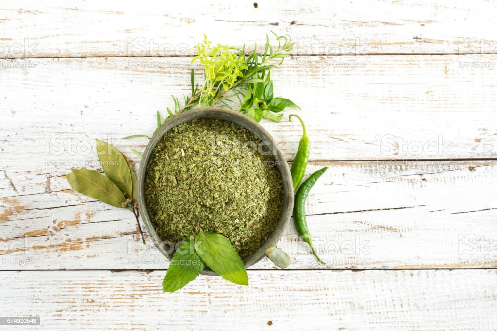 Spices and herbs on wooden background royalty-free stock photo
