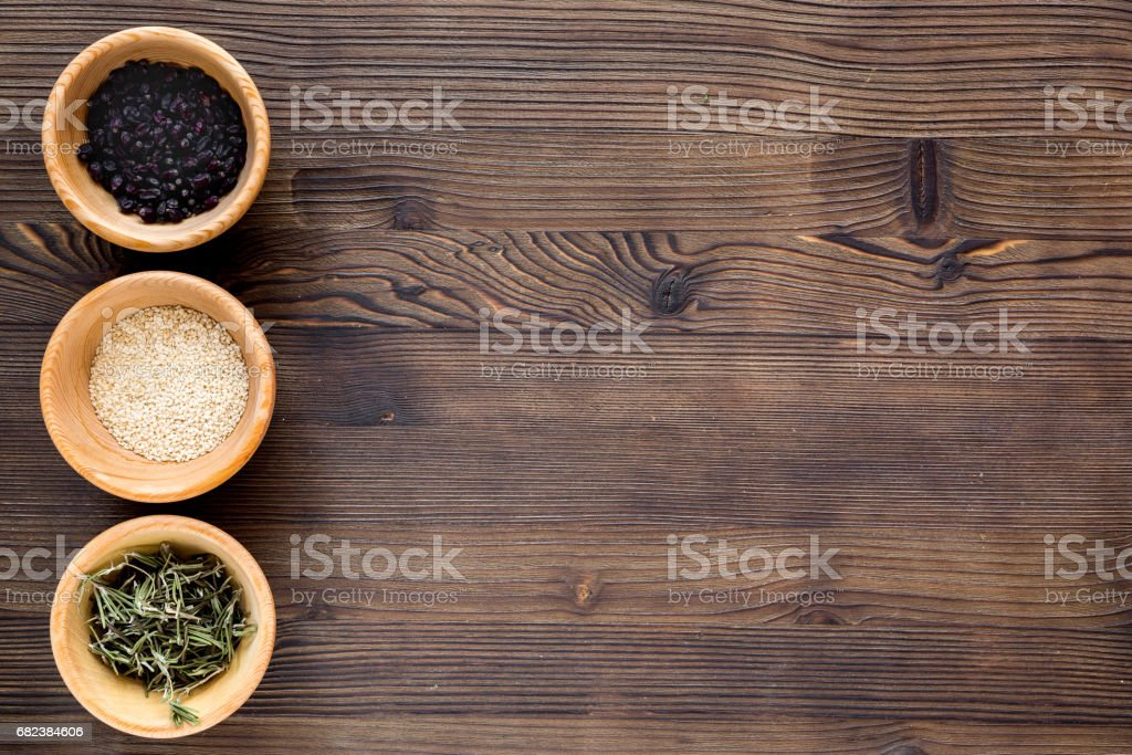 Spices and herbs on wooden kitchen table background top view mock up royalty-free stock photo