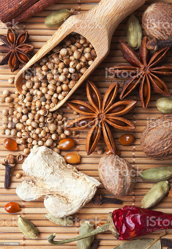 Spices and herbs over bamboo mat royalty-free stock photo