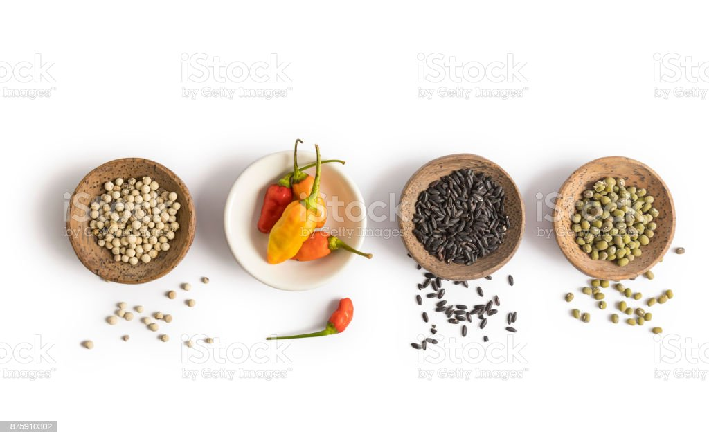 Spices and herbs placed in bowls isolated on white background foto stock royalty-free
