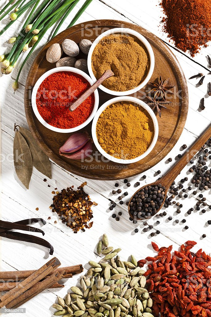 Spices and herbs shot directly above on white table stock photo