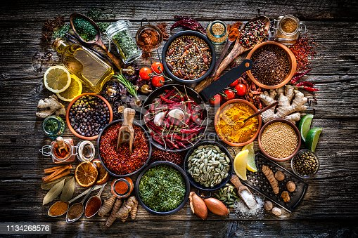 istock Spices and herbs shot from above on rustic wooden table 1134268576