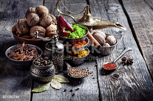 istock Spices and nuts at wooden table 521262744
