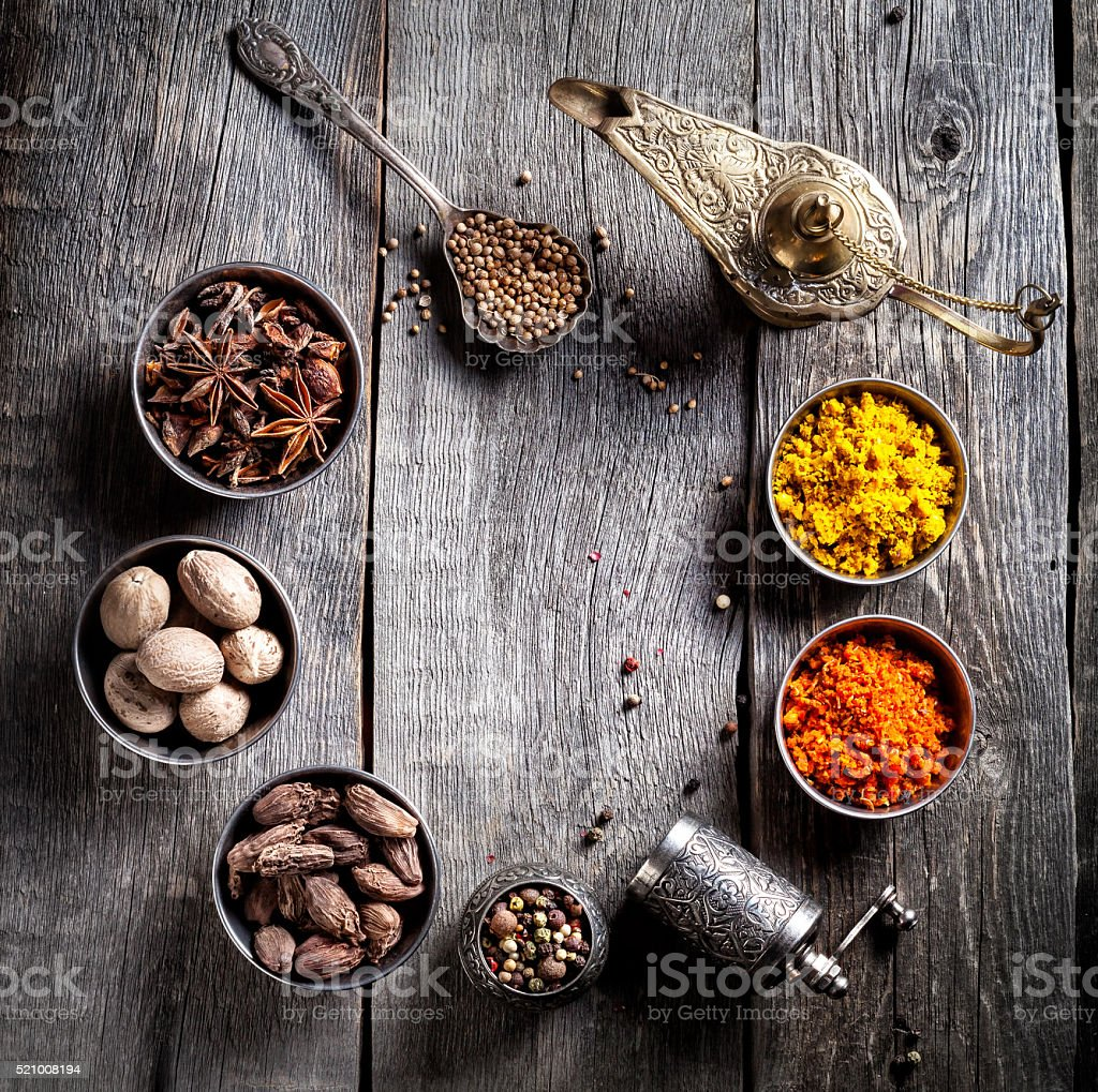 Spices at wooden table stock photo